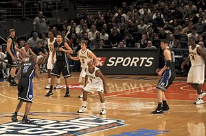 2008–09 Duke Blue Devils men's basketball team - Smith (2), McClure (14), Zoubek (55), and Pocius (5) set up an offensive set vs. Michigan at the 2k Sports Classic Final (2008-11-21)