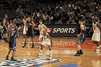 2008–09 Michigan Wolverines men's basketball team - Shepherd (22), Novak (0), Lee (2), and Sims (34) defend against Duke at 2k Sports Classic (2008-11-21)