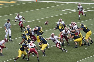 2009 Michigan Wolverines football team - Brandon Minor runs with blocking from Kevin Grady (24), Mark Huyge (72), Martell Webb (80), Mark Ortmann (71), David Moosman (60), Steven Schilling (52), and Perry Dorrestein (79)