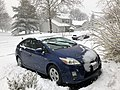 2018-03-21 11 21 03 A Prius in the snow along Tranquility Court in the Franklin Farm section of Oak Hill, Fairfax County, Virginia.jpg