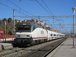 252-053-4 with talgo train at Castelldefels.jpg