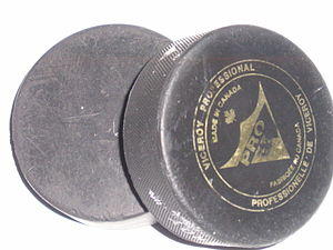 Two standard hockey pucks