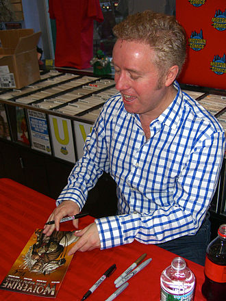 Old Man Logan - Writer Mark Millar signing a copy of the collected edition during an appearance at Midtown Comics in Manhattan