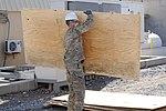 489th Engineer Battalion deconstructs building on KAF 140111-A-MU632-783.jpg