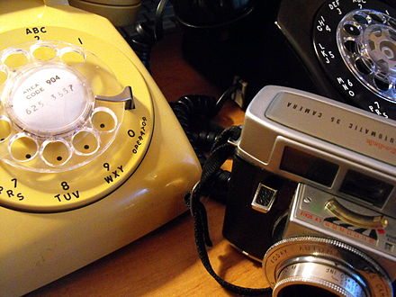 Examples of 1960s technology, including two rotary-dial telephones and a Kodak camera. 60s tech.jpg