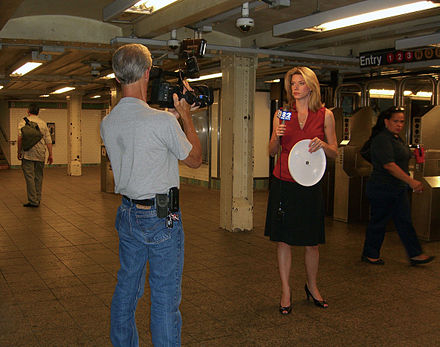 Reporter Kathryn Brown reporting on the Summer 2012 North American heat wave from the Times Square subway station on July 18, 2012. - WCBS-TV