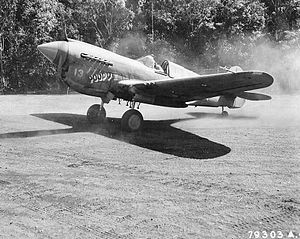 "Girua Airport -  ""Poopy II"" P-40E Warhawk Assigned to 1st Lt. A.T. House,Jr. from the 7th Fighter Squadron, 49th Fighter Group. He was an ace with a total of 5 victories. Photo was taken while preparing to take-off after getting an alert for enemy aircraft at Dobodura in May 1943."