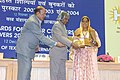 A.P.J. Abdul Kalam giving away the National Awards for Master Craftpersons and Weavers-2002 to Smt. Radhaben Nihal Rathod for her excellent work in Kharek-Soof Embroidery, at a function.jpg