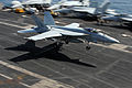 A U.S. Navy F-A-18E Super Hornet aircraft assigned to Strike Fighter Squadron (VFA) 143 lands aboard the aircraft carrier USS Dwight D. Eisenhower (CVN 69) in the Arabian Sea March 28, 2013 130328-N-GC639-109.jpg
