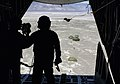 A US Air Force (USAF) Pararescueman assigned to the 71st Rescue Squadron (RQS), parachute from a HC-130 Hercules aircraft during a Combat Search and Rescue training mission during D - DPLA - 0df84c27a1b8ef8902d4560bf3a3fd78.jpeg
