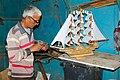 A man making a sailboat.jpg