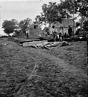 Military history of African Americans in the American Civil War - African-American laborers bury the dead at Fredericksburg, Virginia, 1862.