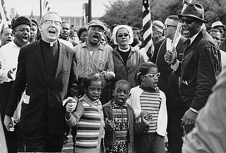 The Selma to Montgomery marchers arrive in Montgomery. At center are Martin Luther and Coretta Scott King, with Ralph Abernathy's three children. Abernathy Children on front line leading the SELMA TO MONTGOMERY MARCH for the RIGHT TO VOTE.JPG