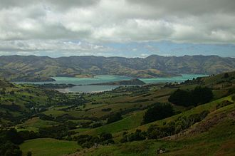 Akaroa - View of Akaroa harbour. The long, thin peninsula extending out into the harbour is Ōnawe Peninsula, and the middle of the volcano.