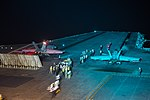 An F A-18E Super Hornets prepare to launch during night flight operations. (26691976607).jpg