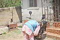 An Okada man cleaning his ride1.jpg