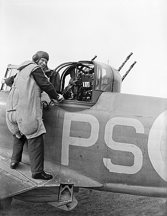"Boulton Paul Defiant - An air-gunner of 264 Squadron wearing a GQ Parasuit, or ""rhino suit"", August 1940"