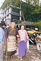 An old lady is assisted to come to a polling station to cast her vote in Gangtok of Sikkim on May 10, 2004.jpg