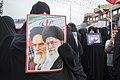 Anniversary of Islamic Revolution In qom- Iran راهپیمایی روز بیست و دوم بهمن ماه در شهر قم حضور مادران شهید با عکس فرزندان شهیدشان.jpg