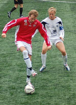 Ålgård FK - Ålgårds captain, Oddbjørn Sivertsen (white jersey), with an Askøy–player, in the match in 2nd division at Kleppestø 4 August 2007.  Photo: Rune Sattler
