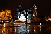The Parish Church of St. Nicholas and the Atlantic Tower hotel near Pier Head. The Atlantic Tower was designed to resemble the prow of a ship to reflect Liverpool's maritime history
