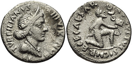 A denarius struck in 19 BC during the reign of Augustus, with the goddess Feronia depicted on the obverse, and on the reverse a Parthian man kneeling in submission while offering the Roman military standards taken at the Battle of Carrhae Augustus Denarius 19 BC 2230399.jpg