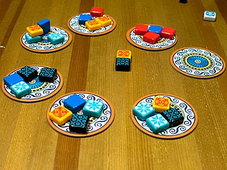 Azul (board game) - Tile repositories. When tiles of a color are taken from any of the cardboard discs, the leftover tiles on that disc are moved to the center.
