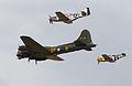 B-17 escorted by P-51 Mustangs (5921834495).jpg