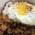 BBQ garlic fried rice with baby back ribs, green onions, and obligatory fried egg. -) (14690793306).jpg