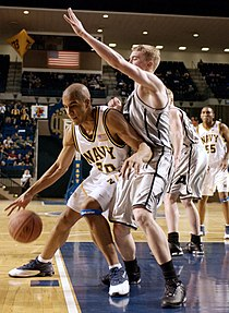 "A U.S. Naval Academy (""Navy"") player, left, posts up a U.S. Military Academy (""Army"") defender"