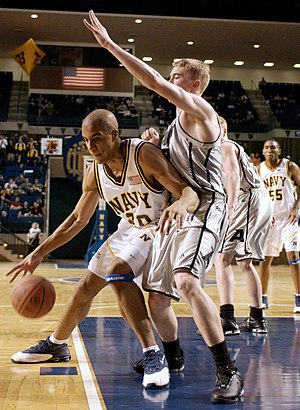 Navy Midshipmen - Navy Midshipman George O'Garro attempts to score during the Army–Navy basketball game in Alumni Hall at the U.S. Naval Academy on January 31, 2004.