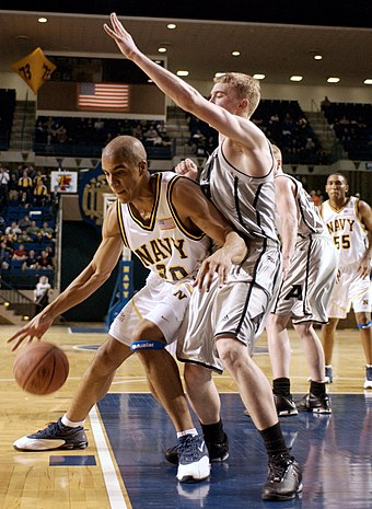 "A U.S. Naval Academy (""Navy"") player, left, posts up a U.S. Military Academy (""Army"") defender. Basketball game.jpg"