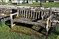 Bench outside the churchyard of St Mary's Church, Great Canfield.jpg