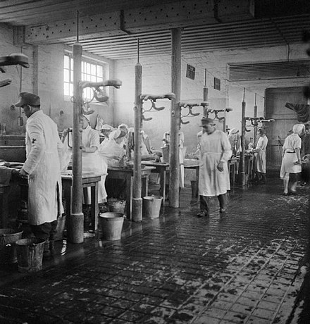 Some of the 60 tables, each staffed by two German doctors and two German nurses, at which the sick were washed and deloused, May 1-4, 1945 Bergen Belsen Liberation 05.jpg