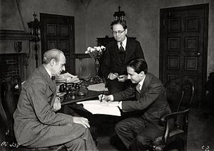 Carl Laemmle Jr. - L. to. R. : Joseph P. Bickerton Jr. (theatre producer), Elmer Rice (playwright) and Carl Laemmle Jr. sign a contract for the film version of Counsellor at Law