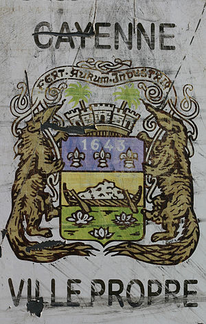 Cayenne - Cayenne's coat of arms on a municipal sign.