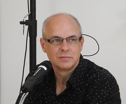 "Brian Eno (pictured in 2008) is credited with coining the term ""ambient music"" Brian Eno 2008.jpg"