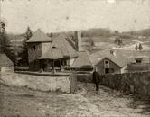 Monochrome photograph of farm buildings