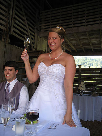 Toast (honor) - A bride offering a toast at a wedding