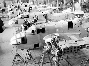 Lightening holes - Aircraft manufacturing in Australia 1943, note the lightening holes on the wing sections