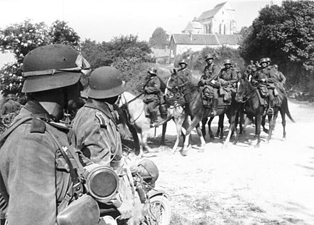 A German cavalry patrol in May 1940, during the Battle of France. Bundesarchiv Bild 101I-054-1525-26, Frankreich, Kavallerie am Ausgang eines Dorfes.jpg