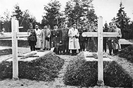 Secretary of State of the Vichy regime Fernand de Brinon and others in Katyn at the graves of Mieczyslaw Smorawinski and Bronislaw Bohatyrewicz, April 1943 Bundesarchiv Bild 183-J15385, Katyn, Offnung der Massengraber, Graber polnischer Generale.jpg