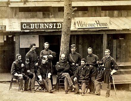 Burnside (seated, center) and officers of the 1st Rhode Island at Camp Sprague, Rhode Island, 1861 Burnside with 1stRI.jpg