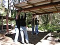 Camp Waskowitz - raising a shelter roof 03.jpg