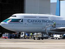 A Cathay Pacific Boeing 747-400 being cleaned at London Heathrow Airport,A South African Airways Wingtip can be seen on the left hand side of the image