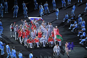 2016 Summer Paralympics opening ceremony - The Belarusian delegation at the Parade of Nations carrying both the Belarusian and Russian flags.