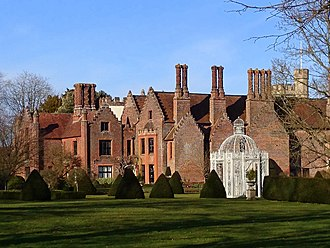 Chenies Manor House - The south western corner, viewed from the south. To the left can be seen the oldest surviving part of the building. To the right, the south facade showing its lack of windows.