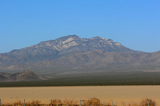 Clark Mountain (California) - The mountain is prominently visible to motorists on Interstate 15 crossing Ivanpah Dry Lake.