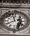Cleaning the clock face of Sydney Town Hall, George Street Sydney, 1937.jpg