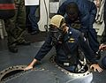 Cmdr. Kevin Kennedy ispects USS Gravely. (9467390158).jpg